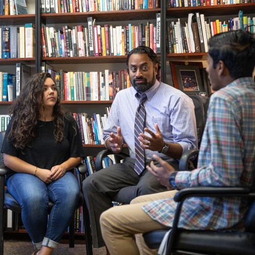 Counseling faculty, Ben Mathew, with students