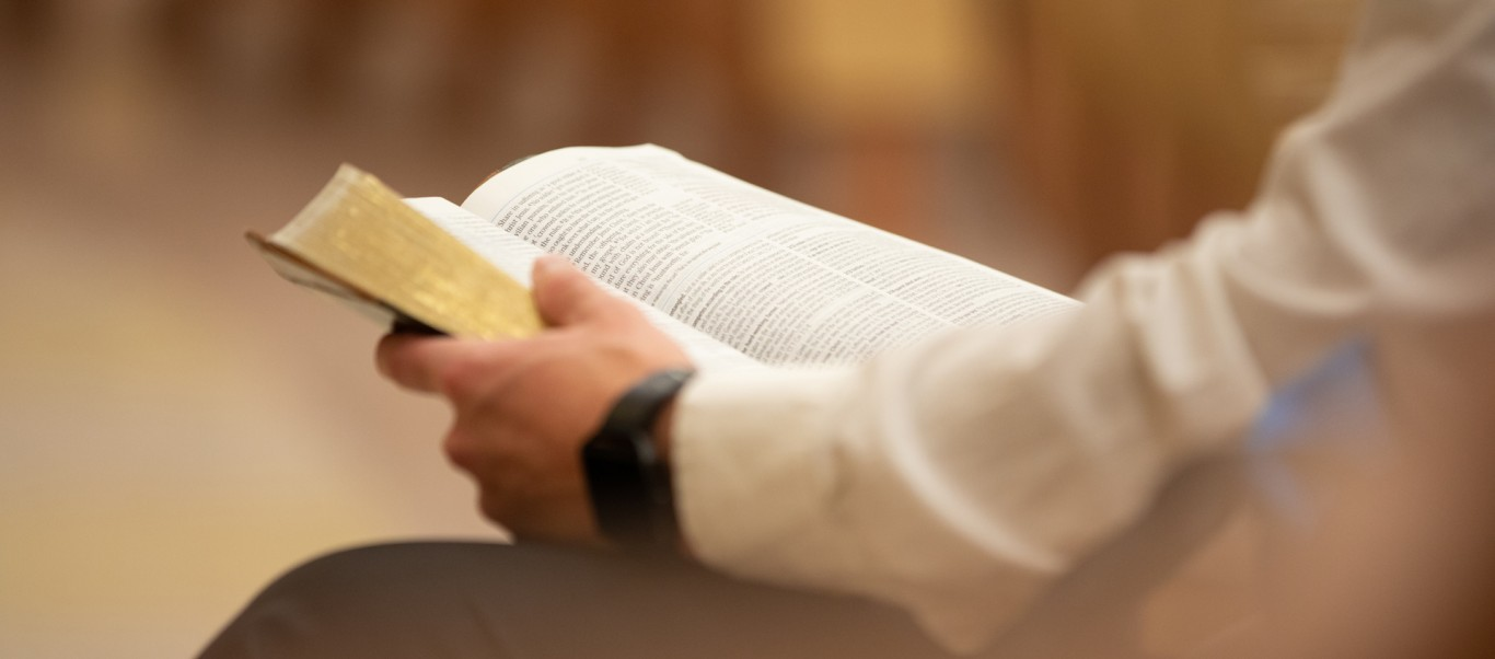Student holding open Bible
